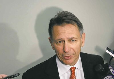 Carlos Osorio / the associated press files Detroit has extended the contract of GM Ken Holland through the 2017-18 season.