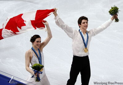Canada's Tessa Virtue and Scott Moir take a victory lap Monday.