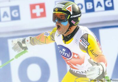 Mario Curti / the associated pressKnee and back problems be darned, Calgary�s Jan Hudec celebrates after winning a World Cup downhill for the first time in four years in Chamonix, France, Saturday.