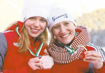 Arno Balzarini / the associated pressCanadians Kaillie Humphries, right, and Chelsea Valois show off their medals on Saturday in Switzerland.