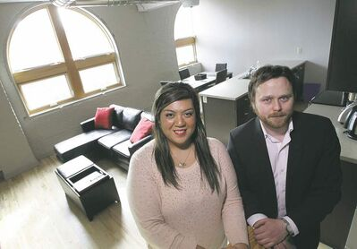 MIKE DEAL / WINNIPEG FREE PRESS  Danda Santos, a newcomer to Winnipeg, in her Penthouse complex rental suite. With her is Kendall Hines, the project's director of marketing.