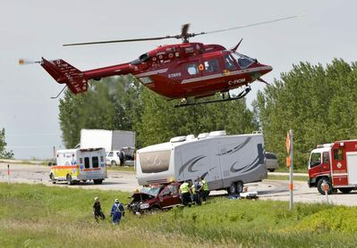 A STARS air ambulance lands at the scene of a crash on the eastbound Portage la Prairie bypass Tuesday afternoon.  The crash killed one person and sent two others to hospital, STARS officials said.