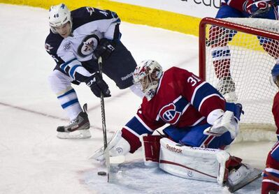 Habs goalie Carey Price denies Winnipeg Jets' Spencer Machacek on the doorstep Sunday afternoon at the Bell Centre.