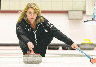 Mike Deal / Winnipeg Free PressSkip Shannon Kleibrink throws a rock during a B-side qualifier against Team McCarville on Sunday at the Fort Rouge Curling Club.