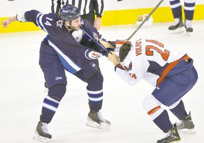 Fred Greenslade / reutersWinnipeg Jets� Anthony Peluso (L) broke his hand on Aaron Volpatti�s head during a first-period scrap Saturday at the MTS Centre.