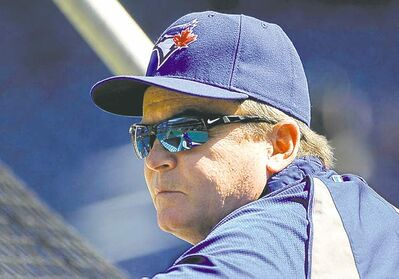 Kathy Kmonicek / the associated press archivesBlue Jays manager John Gibbons takes in batting practice Tuesday.