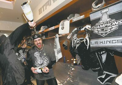 Dave Sandford / the associated pressKings centre Anze Kopitar gets a champagne shower in the locker-room after the Kings beat the New York Rangers 3-2 in overtime to win the Stanley Cup.
