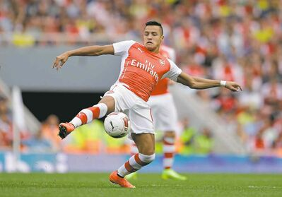 Making his debut Arsenal's Alexis Sanchez controls the ball during the Emirates Cup soccer match between between Arsenal and Benfica at Arsenal's Emirates Stadium in London, Saturday, Aug 2.