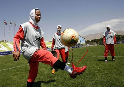In this June, 25, 2009, file photo, unidentified Iranian female national soccer players attend in a training session in Tehran, Iran. THE CANADIAN PRESS/AP, ISNA, Amir Pourmand