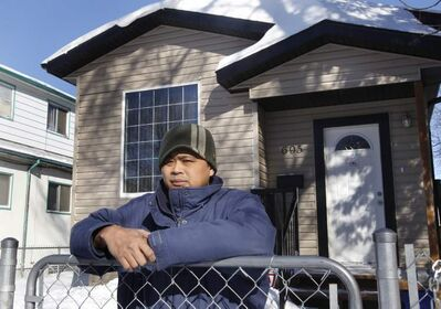 Arnel Mercado outside his Pritchard Avenue home. He wonders why homeowners don't have more rights.