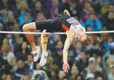 sean kilpatrick / the canadian pressDerek Drouin soars to a bronze medal in the men�s high jump final at the Olympic Stadium, clearing the bar at 2.29 metres on Tuesday. It was Canada�s 11th medal of the Games.