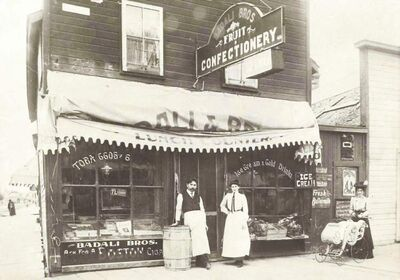 Joe Badai in front of his store on Portage and Smith 1901