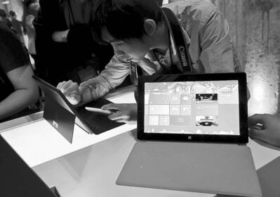 The Associated Press ArchivesA man in Shanghai test drives a new Microsoft Surface tablet.