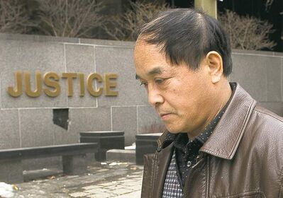 Daran Lin, the father of murder victim Jun Lin, leaves court in Montreal on Monday.
