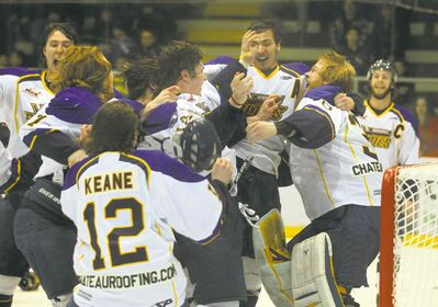 photos by phil hossack / winnipeg free pressThe Winnipeg Blues swarm netminder Byron Spriggs after their 5-1 win Tuesday to win the MJHL championship with a 4-1 series victory.