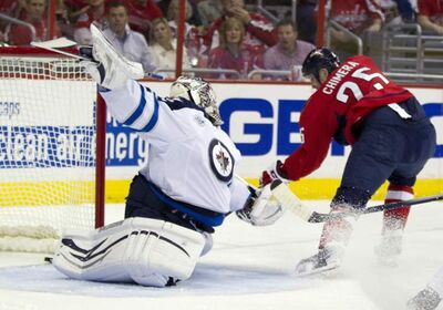 Winnipeg Jets goalie Ondrej Pavelec gets beat by Washington Capitals left wing Jason Chimera for a goal during the first period of their game in Washington on Friday.
