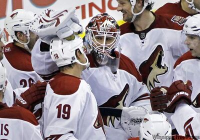 Phoenix Coyotes' Shane Doan, left, gets a tap on the helmet from goalie Ilya Brygalov as the team celebrates Doan's overtime goal in an NHL hockey game, Tuesday, Feb. 22, 2011, in Philadelphia. The Coyotes defeated the Philadelphia Flyers 3-2.