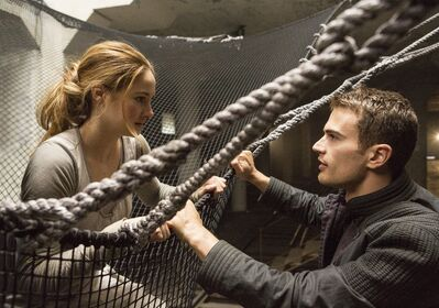 Shailene Woodley (left) and Theo James star in Divergent.