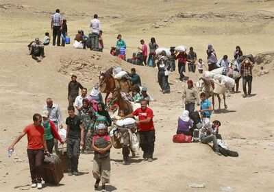 AP10ThingsToSee - FILE - Syrian refugees cross into Iraq at the Peshkhabour border point in Dahuk, 260 miles (430 kilometers) northwest of Baghdad, Iraq, Tuesday, Aug. 20, 2013. Around 30,000 Syrians, the vast majority of them Kurds, have fled the region over a five-day stretch and crossed the border to the self-ruled Kurdish region of northern Iraq. (AP Photo/Hadi Mizban)