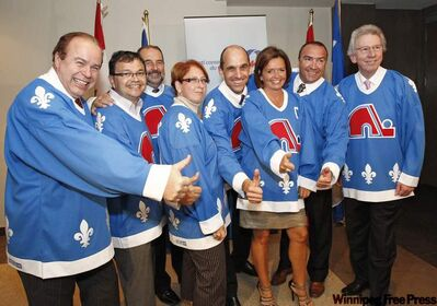 Quebec Conservative MPs wear Quebec Nordique jerseys during a caucus meeting in Quebec City on Sept. 8, 2010. The MPs wore the jerseys to support the construction of a new arena.