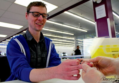 Ken Mason gets his blood typed at a clinic at the West Portage Y last week.