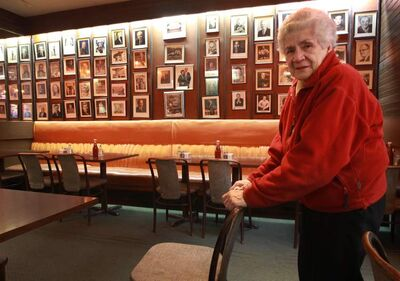 Mary Kelekis stands inside restaurant this morning.