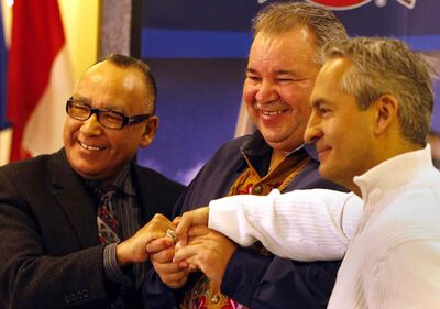 From left:  Norway House Cree Nation Chief Ron Evans, Manitoba Metis Federation President David Chartrand and Sagkeeng First Nation Chief Donovan Fontaine celebrate the joint MEDO Care Pharmacy agreement.