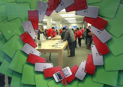 Shoppers search for deals at the Polo Park Apple Store on Black Friday. For the most part, crowds resembled any other weekday at the St. James shopping centre.