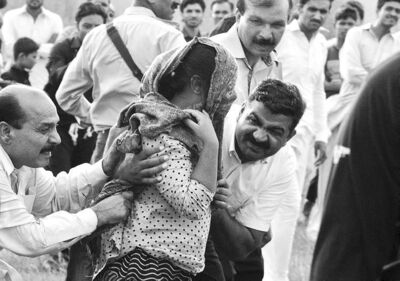 A Pakistani police official and a Christian volunteer escort a young Christian girl accused of blasphemy, towards a helicopter following her release from prison on the outskirts of Rawalpindi, Pakistan.