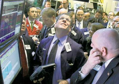Equities on the New York Stock Exchange (above) gained this week after Spain announced budget cuts.