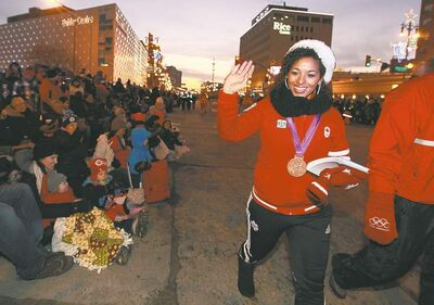 Olympic medal winner Desiree Scott  led the way as 60,000 parents and kids lined Portage Avenue  for the annual Santa Claus Parade.