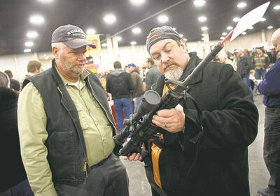 BEN BREWER / THE ASSOCIATED PRESSAttendees at a Utah gun show Saturday peruse an AR-15, the type used in the Newtown massacre.Gun owners discuss a potential sale of an AR-15, one of the most popular and controversial weapons, during the 2013 Rocky Mountain Gun Show at the South Towne Expo Center in Sandy, Utah Saturday, Jan. 5, 2013. In spite of the recent school shooting in Newtown, Conn., gun enthusiasts packed in by the hundreds to purchase weapons and ammunition. The gunman in the Sandy Hook Elementary School shooting in December used an AR-15 to kill 20 first-graders and six educators in the school before killing himself as police closed in. (AP Photo/The Deseret News, Ben Brewer)