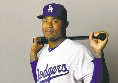 Los Angeles Dodgers outfielder Carl Crawford poses during photo day before a baseball spring training baseball workout in Phoenix, Sunday, Feb. 17, 2013. (AP Photo/Paul Sancya)