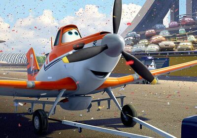 Cook (below) is the toned-down voice behind Dusty the crop duster (above) in the new Disney feature, Planes.