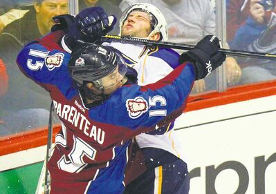 Fans react while watching Colorado Avalanche's P.A. Parenteau (15) high-stick St. Louis Blues' David Backes (42).