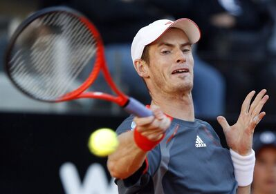 Britain's Andy Murray returns the ball to Argentina's David Nalbandian at the Italian Open tennis tournament, in Rome, Tuesday, May 15, 2012. (AP Photo/Andrew Medichini)