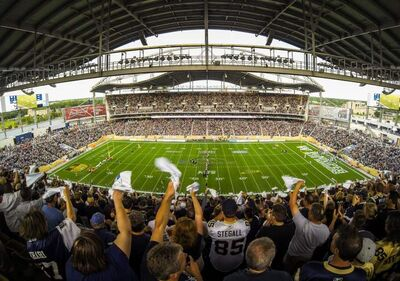 The crowd at the inaugural regular season game at Investors Group Field in Winnipeg on June 27, 2013.