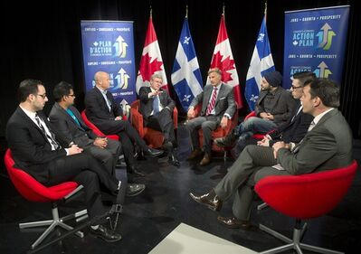 Prime Minister Stephen Harper, 4th from left, takes part in a photo opportunity with entrepreneurs at CBC headquarters Monday, January 14, 2013 in Montreeal.THE CANADIAN PRESS/Ryan Remiorz