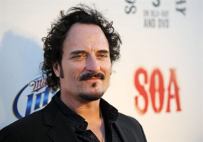"Kim Coates, a cast member in ""Sons of Anarchy,"" poses at a screening of the fourth season premiere of the television series, Tuesday, Aug. 30, 2011, in Los Angeles. Coates is so convincing on ""Sons of Anarchy"" that real-life bikers like to give him their opinion of the show. THE CANADIAN PRESS/AP-Chris Pizzello"