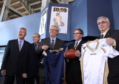 Under the grandstand in Canad Inns Stadium (from left) Ken Hildahl, Chair, Board of Directors of the Winnipeg Football Club, Mayor Sam Katz, Premier Greg Selinger, David Asper, Executive Chairman of Creswin Properties Inc. and David Barnard, pres. of the University of Manitoba.