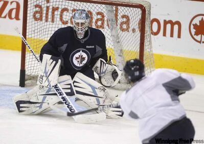 Winnipeg Jets' goaltender Chris Mason, seen during practice last week, was not at practice today as his wife is about to have a baby.