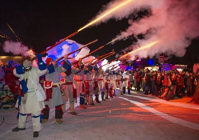 Rifles fire into the air to officially open the Festival du Voyageur Friday night at Voyageur Park. The Festival has been named a top tourist destination by the American Bus Association.