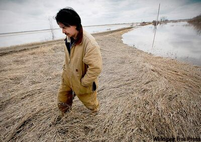 JOHN.WOODS@FREEPRESS.MB.CAGerald Tait, assistant EMO on Roseau River First Nation, stands on a community ring dike on Tuesday. The reserve is threatened by the Red and Roseau rivers.