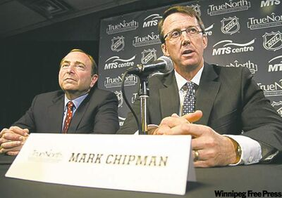 True North Sports and Entertainment Limited chairman Mark Chipman (right) speaks beside NHL commissioner Gary Bettman during a press conference in Winnipeg.