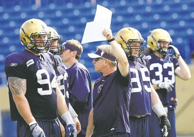 PHOTOS BY KEN GIGLIOTTI  / WINNIPEG FREE PRESSDefensive co-ordinator Tim Burke calls a play during practice  on Thursday at Canad Inns Stadium.