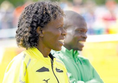 Winning smiles: Anne Kibor and Thomas Omwenga