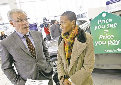 MIKE DEAL / WINNIPEG FREE PRESSPremier Greg Selinger talks with Beatrice Dyce of the Consumer Protection Office at the announcement Monday.