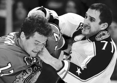 Nam Y. Huh / the associated pressColumbus forward Nick Foligno (right) exchanges blows with Chicago tough guy Sheldon Brookbank during first-period action.