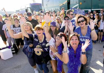 Ruth Bonneville / Winnipeg Free Press Faithful Winnipeg Blue Bombers fans beseech higher powers for a win in the Labour Day Classic game before they board a bus for Regina on Saturday.