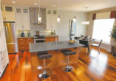 The kitchen is defined neatly by a mid-sized island.
